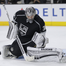 Los Angeles Kings goalie Jonathan Quick stops an Edmonton Oilers shot during the third period of an NHL hockey game Tuesday, Oct. 14, 2014, in Los Angeles. The Kings won 6-1 The Associated Press