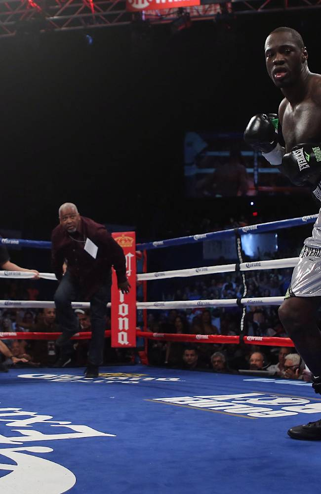 WBC Continental Americas Heavyweight Champion Deontay Wilder, right, celebrates after defeating by KO in the first round Malik Scott during their heavyweight bout at the Ruben Rodriguez Coliseum in Bayamon, Puerto Rico, Saturday, March 15, 2014
