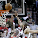 Portland Trail Blazers forward Nicolas Batum, from France, right, goes up for a rebound with Atlanta Hawks forward Pero Antic, from Macedonia, during the second half of an NBA basketball game in Portland, Ore., Wednesday, March 5, 2014. Batum scored 14 p