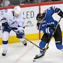 Tampa Bay Lightning defenseman Victor Hedman, left, of Sweden, and Colorado Avalanche defenseman Tyson Barrie, right, fight for the puck in the first period of an NHL hockey game, Sunday, March 2, 2014 in Denver The Associated Press