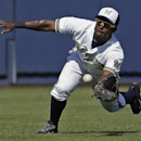 Milwaukee Brewers' Elian Herrera catches a ball hit by San Diego Padres' Carlos Quentin during the fifth inning of an exhibition spring training baseball game on Friday, March 7, 2014, in Phoenix The Associated Press