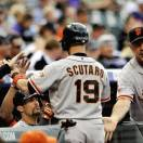 San Francisco Giants' Marco Scutaro is congratulated by teammates after scoring a run on a Buster Posey sacrifice fly against the Colorado Rockies against the Colorado Rockies during the first inning of a baseball game on Friday, May 17, 2013, in Denver. (AP Photo/Jack Dempsey)
