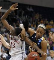 Stanford forward Chiney Ogwumike (13) and West Virginia center Asya Bussie (20) struggle for a rebound during the first half of an NCAA women's basketball tournament second-round game in Norfolk, Va., Monday, March 19, 2012. (AP Photo/Steve Helber)