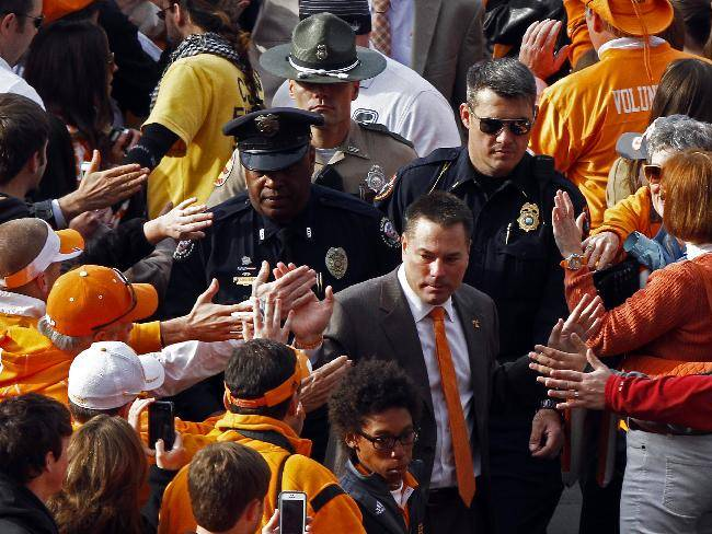 Tennessee head coach Butch Jones makes his way through fans during the Vol Walk before an NCAA college football game against Auburn on Saturday, Nov. 9, 2013 in Knoxville, Tenn