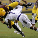 Weber State safety Josh Burton (7) stops Arizona State running back D.J. Foster during the first half of an NCAA college football game, Thursday, Aug. 28, 2014, in Tempe, Ariz The Associated Press