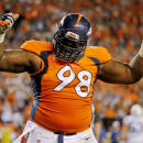 FILE - In this Sept. 7, 2014, file photo, Denver Broncos defensive tackle Terrance Knighton (98) celebrates a stop during the second half of an NFL football game against the Indianapolis Colts in Denver. Knighton isn't backing down from his Super Bowl guarantee, saying anything less than a world championship will be a disappointing season for the star-studded Denver Broncos. (AP Photo/Jack Dempsey, File)