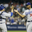 Los Angeles Dodgers' Kenley Jansen (74) is congratulated by teammate Tim Federowicz after pitching the ninth inning in a 8-6 victory over the Arizona Diamondbacks during a baseball game on Sunday, April 13, 2014, in Phoenix The Associated Press