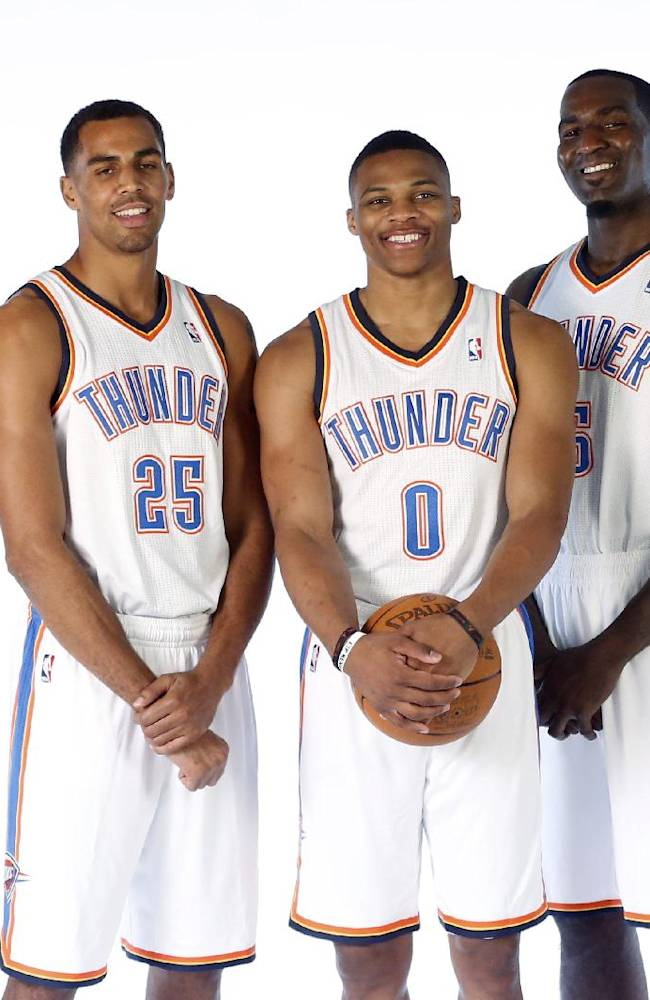 The Oklahoma City Thunder's starting five, from left, Serge Ibaka, Thabo Sefolosha, Russell Westbrook, Kendrick Perkins and Kevin Durant, pose for a group photo during NBA basketball media day in Oklahoma City, Friday, Sept. 27, 2013