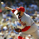 St. Louis Cardinals relief pitcher Jason Motte (30) throws against the Los Angeles Dodgers in the eighth inning of a baseball game on Sunday, June 29, 2014, in Los Angeles. (AP Photo/Alex Gallardo)