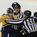 Linesmen Greg Devorski (54) and Trent Knorr (63) restrain Nashville Predators forward Colin Wilson (33) from fighting with Buffalo Sabres defenseman Rasmus Ristolainen (55), of Finland, in the third period of an NHL hockey game on Thursday, March 27, 2014