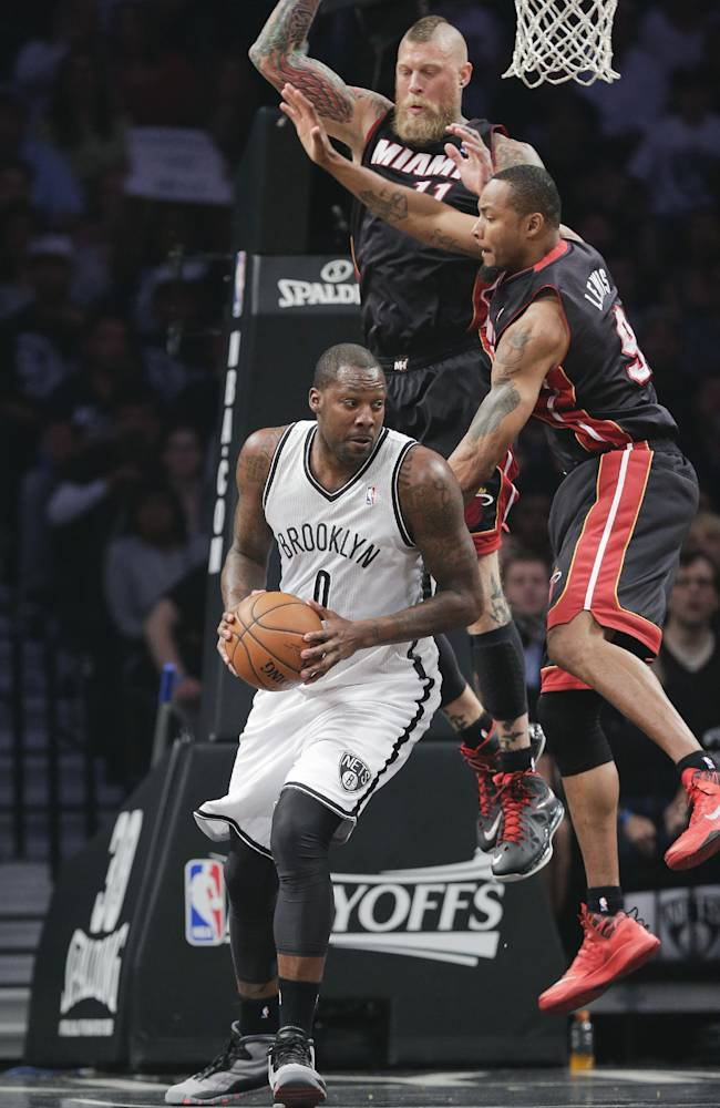 Miami Heat forward Rashard Lewis (9) and forward Chris Andersen (11) double-team Brooklyn Nets center Andray Blatche (0) in the first period during Game 3 of an Eastern Conference semifinal NBA playoff basketball game on Saturday, May 10, 2014, in New York