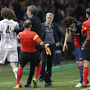PSG's coach Laurent Blanc, centre, separates Chelsea's David Luiz and PSG's Edinson Cavani, 2nd right. as Chelsea's manager Jose Mourinho looks on during the Champions League quarterfinal first leg soccer match between PSG and Chelsea, at the Parc des Pri