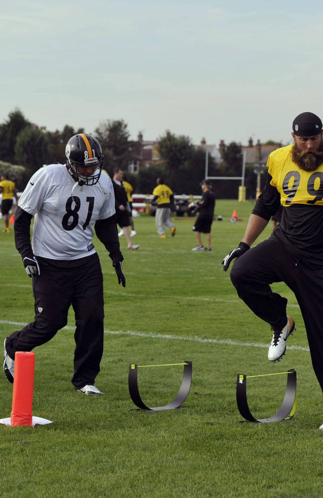 Pittsburgh Steelers' from left,  Michael Palmer, David Paulson and Brett Keisel warm up prior to a practice session, at the Wasps rugby training ground, in London, Friday, Sept. 27, 2013. The Pittsburgh Steelers are to play the Minnesota Vikings in the NFL International Series at Wembley Stadium in London on Sunday, Sept 29