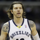 In this Nov. 9, 2013 file photo, Memphis Grizzlies forward Mike Miller watches the first half of an NBA basketball game against the Golden State Warriors in Memphis, Tenn. Miller turned into Memphis' iron man as the only player on the roster to play in al