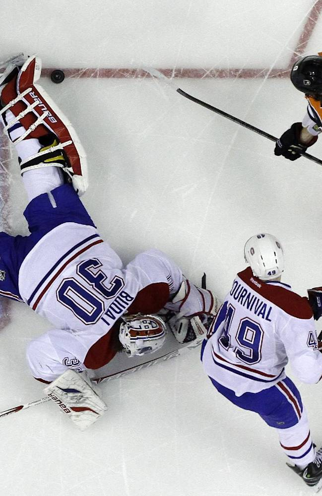 Montreal Canadiens' Peter Budaj (30), of Slovakia, blocks a shot by Philadelphia Flyers' Steve Downie (9) as Michael Bournival (49) defends during the second period of an NHL hockey game, Wednesday, Jan. 8, 2014, in Philadelphia