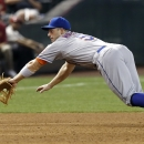 New York Mets' David Wright dives but is unable to come up with a ball hit by Arizona Diamondbacks' Martin Prado during the fifth inning of a baseball game Wednesday, April 16, 2014, in Phoenix The Associated Press