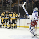 Pittsburgh Penguins defenseman Paul Martin (7), defenseman Brian Dumoulin (8) center Sidney Crosby (87), center Nick Spaling (13) and right wing Steve Downie (23) celebrate Spaling's goal on New York Rangers goalie Henrik Lundqvist (30) in the first pe