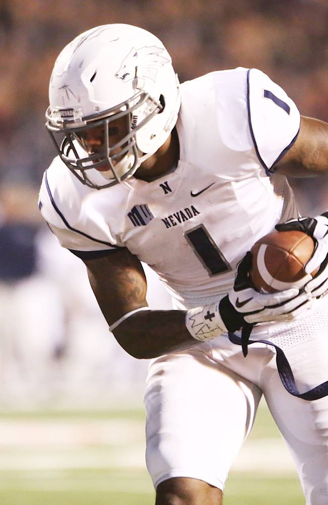 Nevada's Brandon Wimberly (1) heads in for a touchdown against Fresno State's Charles Washington in the second half of an NCAA college football game in Fresno, Calif., Saturday, Nov. 2, 2013