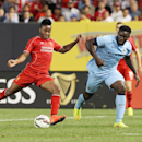 IMAGE DISTRIBUTED FOR GUINNESS INTERNATIONAL CHAMPIONS CUP - Forward Raheem Sterling (31) of Liverpool FC shoots and scores a second half goal while being defended by midfielder Emyr Huws (52) of Manchester City during the Guinness International Champions