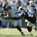 Seattle Seahawks running back Marshawn Lynch (24) runs into Carolina Panthers strong safety Roman Harper (41) during the second half of an NFL football game, Sunday, Oct. 26, 2014, in Charlotte The Associated Press