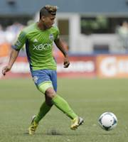Seattle Sounders' DeAndre Yedlin kicks the ball during the second half of an MLS soccer match against the San Jose Earthquakes, Saturday, May 11, 2013, in Seattle. (AP Photo/Ted S. Warren)