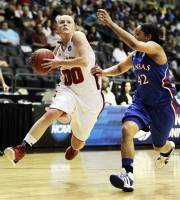 Nebraska's Lindsey Moore (00) moves past Kansas' Natalie Knight (42) during the  first half of an NCAA tournament first-round women's college basketball game in Little Rock, Ark., Sunday, March 18, 2012. (AP Photo/Danny Johnston)