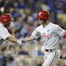 Philadelphia Phillies' Jayson Nix, right, celebrates his home run with Ben Revere during the eighth inning of a baseball game against the Los Angeles Dodgers on Wednesday, April 23, 2014, in Los Angeles The Associated Press