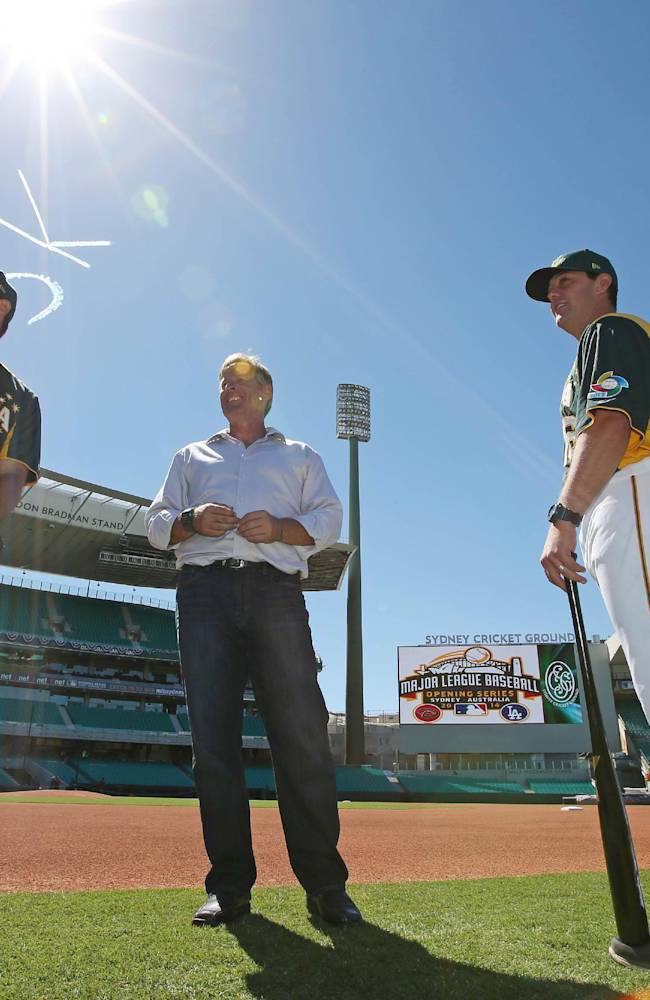 Australian Baseball player Craig Anderson, left, and coaches Jon Deeble and Glenn Williams, right, inspect the baseball field especially built for the Major League Baseball opening series at the Sydney Cricket Ground in Sydney, Monday, March 17, 2014. The MLB season-opening two-game series between the Los Angeles Dodgers and Arizona Diamondbacks in Sydney will be played this weekend
