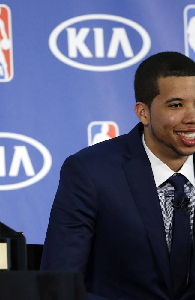 Philadelphia 76ers' Michael Carter-Williams smiles during a news conference where he received the NBA Rookie of the Year award at the team's practice facility, Monday, May 5, 2014, in Philadelphia