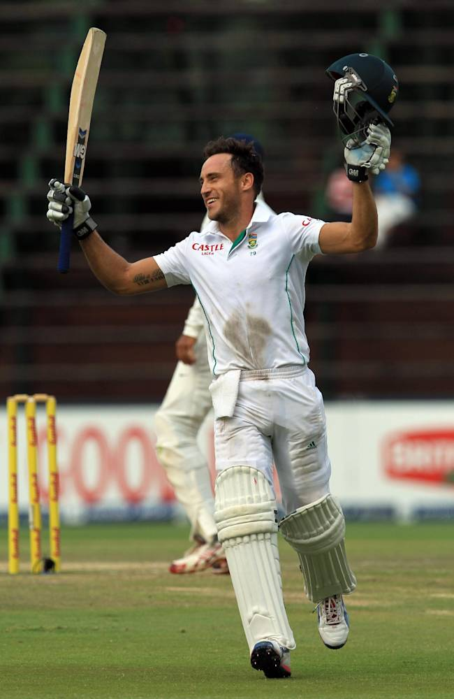 South Africa's batsman Francois du Plessis jumps as he celebrates a century during the fourth and final day of their cricket test match against India at Wanderers stadium in Johannesburg, South Africa, Sunday, Dec. 22, 2013