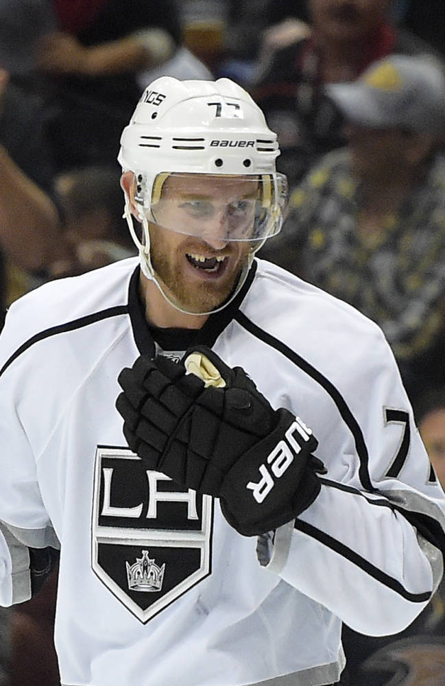 Los Angeles Kings center Jeff Carter, left, smiles at center Tyler Toffoli after defenseman Alec Martinez scored during the first period in Game 2 of an NHL hockey second-round Stanley Cup playoff series, Monday, May 5, 2014, in Anaheim, Calif