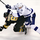 Tampa Bay Lightning center Alex Killorn (17) checks Boston Bruins left wing Brad Marchand (63) to the ice during the third period of an NHL hockey game in Boston, Tuesday, Jan. 13, 2015. The Bruins won 4-3 The Associated Press