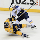 Nashville Predators center Mike Fisher (12) collides with St. Louis Blues right wing Vladimir Tarasenko (91), of Russia, in the third period of an NHL hockey game Thursday, Dec. 4, 2014, in Nashville, Tenn. The Predators won 4-3 The Associated Press
