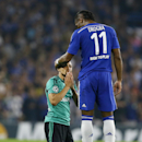 Chelsea's Didier Drogba, right, comforts Schalke's Sidney Sam during the Champions League Group G soccer match between Chelsea and Schalke 04 at Stamford Bridge stadium in London Wednesday, Sept. 17, 2014