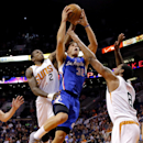 Los Angeles Clippers forward Blake Griffin (32) drives against Phoenix Suns guard Eric Bledsoe (2) forward Channing Frye (8) during the first half of an NBA basketball game on Wednesday, April 2, 2014, in Phoenix The Associated Press
