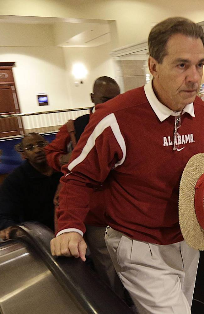 Alabama coach Nick Saban arrives with the football team at its hotel after practice in New Orleans, Friday, Dec. 27, 2013. Alabama will play Oklahoma in the Sugar Bowl on Jan. 2