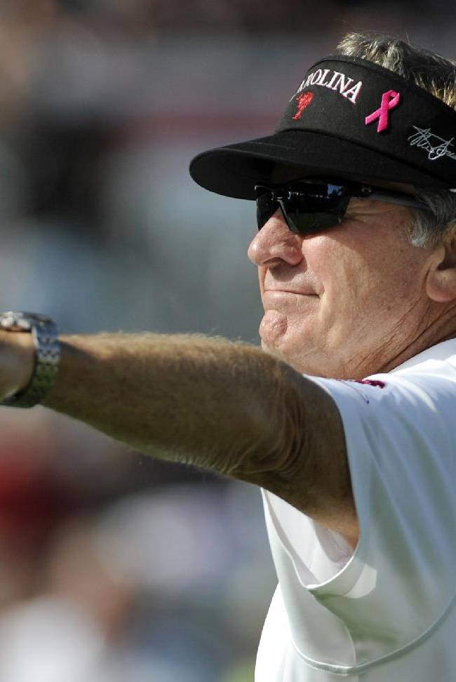 South Carolina coach Steve Spurrier gestures during warm ups before an NCAA college football game against Mississippi State, Saturday, Nov. 2, 2013, in Columbia, S.C