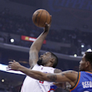 Los Angeles Clippers center DeAndre Jordan, left, goes up for a dunk against Oklahoma City Thunder guard Thabo Sefolosha, right, of Switzerland in the first half of their NBA basketball game Wednesday, Nov. 13, 2013, in Los Angeles The Associated Press
