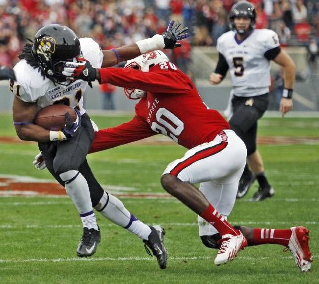 Eastern Carolina's Vintavious Cooper (21) tries to get away from North Carolina State's Hakim Jones (20) during an NCAA college football game in Raleigh, N.C., Saturday, Nov. 23, 2013