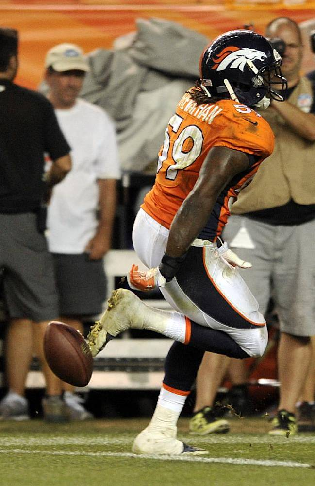 In this Sept. 5, 2013, file photo, Denver Broncos linebacker Danny Trevathan (59) drops the ball before he crosses the goal line for a fumble against the Baltimore Ravens in the second half of an NFL football game in Denver. His season began in embarrassing fashion, but Trevathan promised to learn from his mistake and move on. He's done just that, leading the Broncos in tackles and helping the defense withstand the loss of five starters to injuries to surge into the Super Bowl