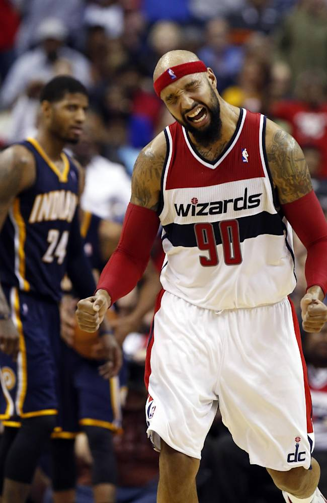 Washington Wizards forward Drew Gooden (90) celebrates after a play with Indiana Pacers forward Paul George (24) nearby in the second half of an NBA basketball game on Friday, March 28, 2014, in Washington. The Wizards won 91-78