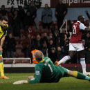 West Ham United's Mohamed Diame, right, celebrates his goal against Norwich City during their English Premier League soccer match at Upton Park, London, Tuesday, Feb. 11, 2014