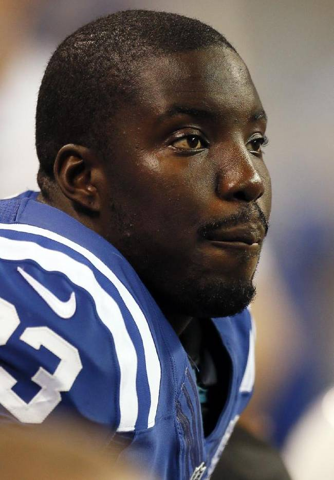 In this Aug. 24, 2013, file photo, Indianapolis Colts cornerback Vontae Davis sits on the bench during the second half of a preseason NFL football game against the Cleveland Browns in Indianapolis. For the first time as pros, Davis could face off against his brother, San Francisco 49ers tight end Vernon Davis, when their two teams meet on Sunday