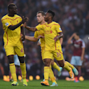 Liverpool's Raheem Sterling, right, celebrates scoring with Liverpool's Mario Balotelli, left, during their English Premier League soccer match against West Ham United at Upton Park, London, Saturday, Sept. 20, 2014