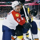 Florida Panthers' Aaron Ekblad (5) and Boston Bruins' Loui Eriksson (21), of Sweden, battle for the puck in the second period of an NHL hockey game in Boston, Tuesday, Nov. 4, 2014 The Associated Press