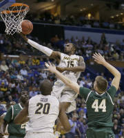 Wichita State guard Nick Wiggins (15) shoots over Cal Poly forward Zach Gordon (44) during the second half of a second-round game in the NCAA college basketball tournament Friday, March 21, 2014, in St. Louis. Wichita State won 64-37. (AP Photo/Jeff Roberson)