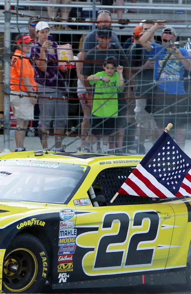 Brad Keselowski does a burnout as he celebrates after winning the NASCAR Nationwide Series auto race at New Hampshire Motor Speedway Saturday, July 12, 2014, in Loudon, N.H