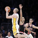 Los Angeles Lakers' Steve Blake, left, shoots as Chicago Bulls' Kirk Hinrich, right, and D.J. Augustin look on during the second half of an NBA basketball game in Los Angeles, Sunday, Feb. 9, 2014 The Associated Press