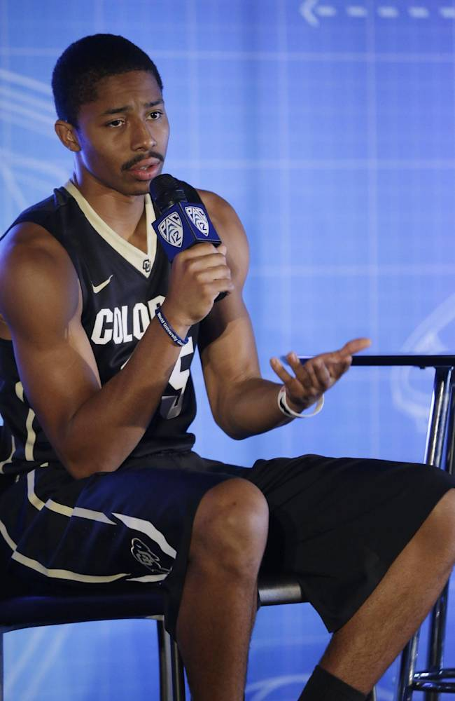 Colorado's Spencer Dinwiddie answers questions during the Pac-12 NCAA college basketball media day, Thursday, Oct. 17, 2013, in San Francisco