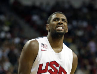 Cleveland Cavaliers' Kyrie Irving reacts after seeing Indiana Pacers' Paul George get injured during the USA Basketball Showcase game Friday, Aug. 1, 2014, in Las Vegas. (AP Photo/John Locher)